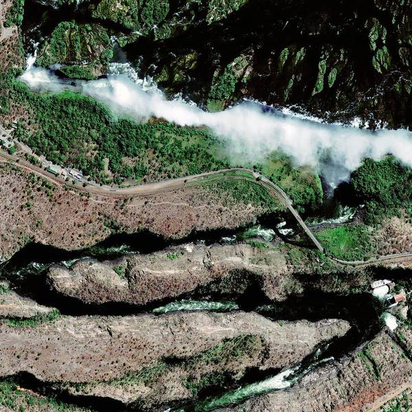 Chasm Photograph - Victoria Falls And Gorge by Geoeye/science Photo Library