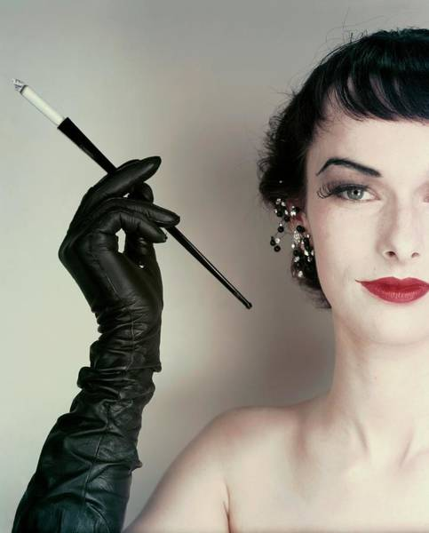 Make Up Photograph - Victoria Von Hagen Holding A Cigarette Holder by Erwin Blumenfeld