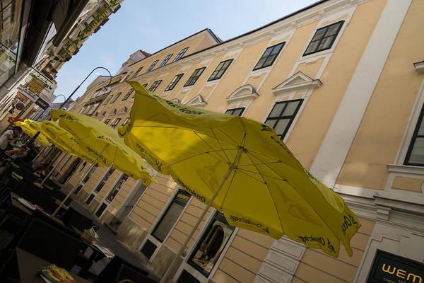 Wall Art - Photograph - Vienna Street Life - Cheery Yellow Umbrellas At An Outdoor Cafe by Georgia Mizuleva