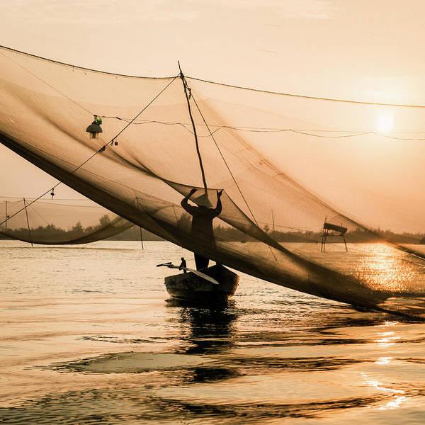 Hoi An Photograph - Vietnam, Traditinal Fisherman Tending by Martin Puddy