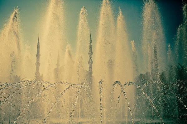 Photograph - view frou fountain Silhouettes of Blue Mosque by Raimond Klavins