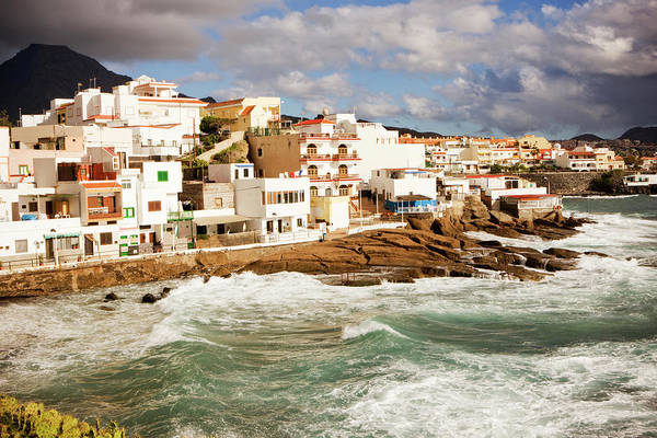Tenerife Photograph - View Of Coastal Village During Storm by Johner Images