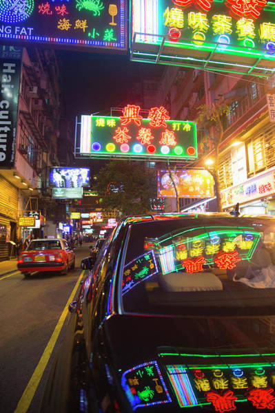 Chinese Language Photograph - View Of Evening Shop Lights by Grant Faint