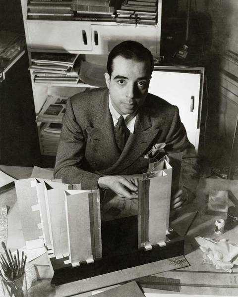 Male Portrait Photograph - Vincente Minnelli Sitting At His Desk by Lusha Nelson