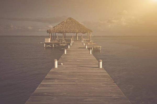 Ambergris Caye Photograph - Vintage Beach Deck With Palapa Floating In The Water by Brandon Bourdages