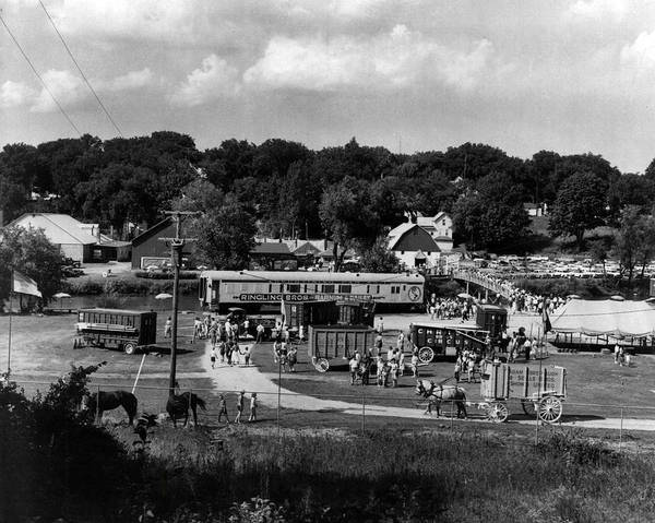 Bailey Photograph - Vintage Circus In Town Setting Up by Retro Images Archive