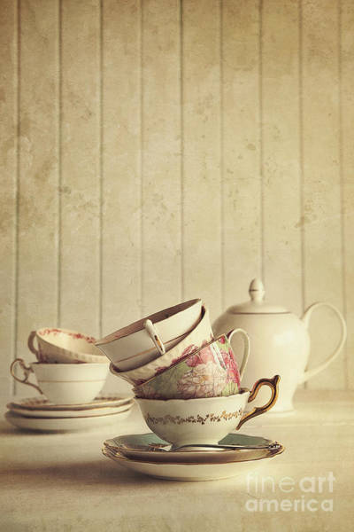Photograph - Vintage Tea Cups Stacked With Wood Background by Sandra Cunningham