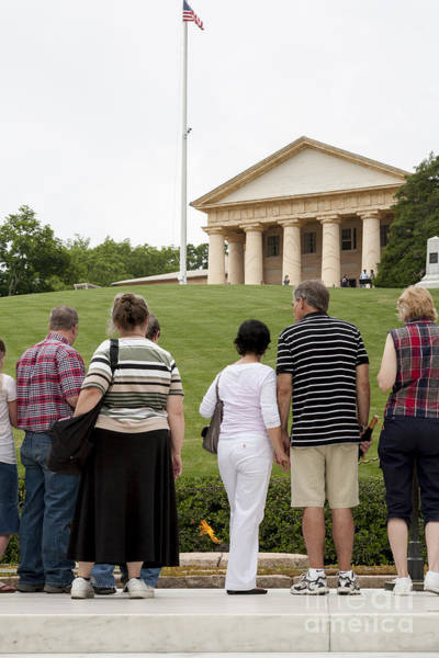Photograph - Visitors At The John F. Kennedy Grave At Arlington National Cemetery With The Arlington House Mansio by William Kuta