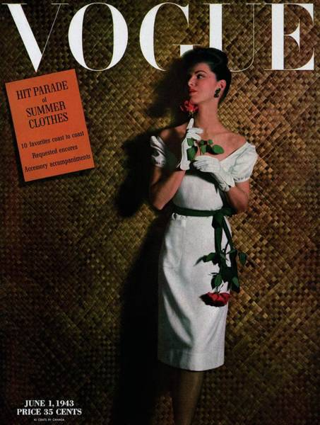 Photograph - Vogue Cover Featuring A Model Holding A Rose by John Rawlings