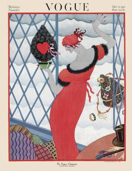 1921 Photograph - Vogue Cover Featuring A Woman Holding A Christmas by Helen Dryden