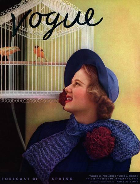 Blue Photograph - Vogue Cover Of Model Looking At Bird Cage by Edward Steichen