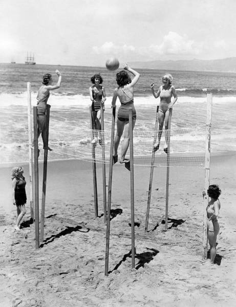 Wall Art - Photograph - Volleyball On Stilts by Underwood Archives