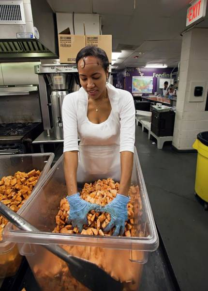 Non Profit Photograph - Volunteer At A Community Kitchen by Jim West