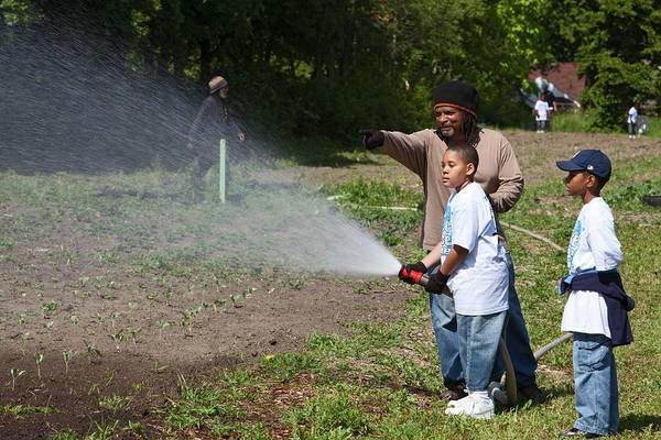 Security Service Photograph - Volunteers At An Urban Farm by Jim West