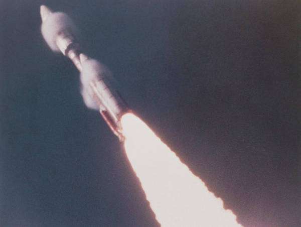 Voyager Photograph - Voyager 1 Launch Vehicle Seen Streaking Into Sky by Nasa/science Photo Library