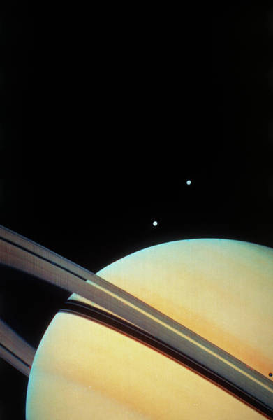 Dione Photograph - Voyager 1 Photo Of Saturn & Two Of Its Moons by Nasa/science Photo Library