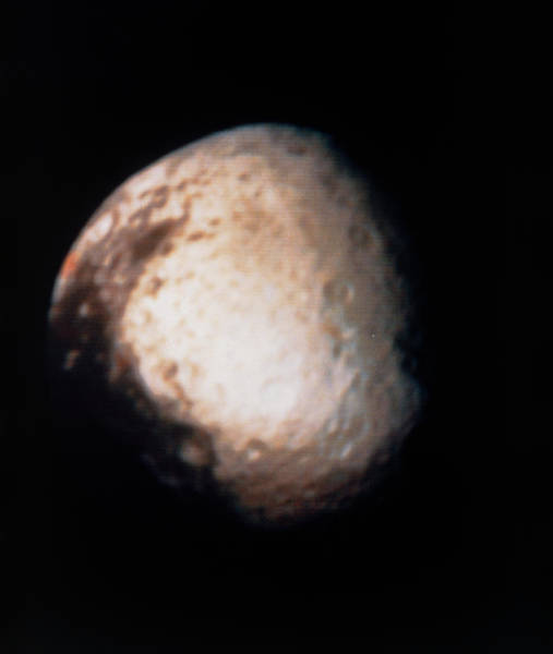 Voyager Photograph - Voyager 2 Photograph Of Saturn's Moon Iapetus by Nasa/science Photo Library