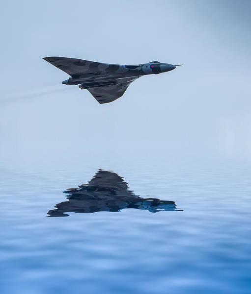 Vulcan Bomber Photograph - Vulcan Over The Water by Paul Madden