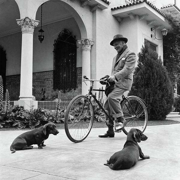 Waldemar Schroder On A Bicycle With Two Dogs Art Print by Luis Lemus