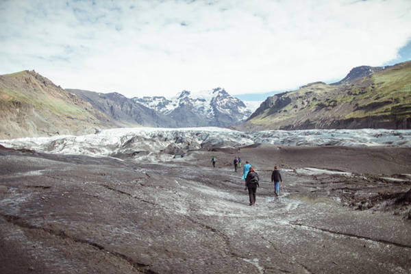 People Walking Photograph - Walking In A Glacier by Oscar Wong