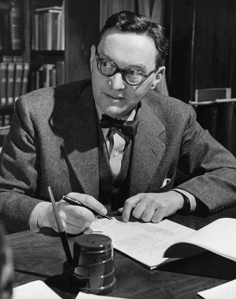 Eyewear Photograph - Walter Lippmann Writing At A Desk by George Karger