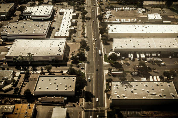 Commercialism Photograph - Warehouses In A City Suburb by Tim Martin