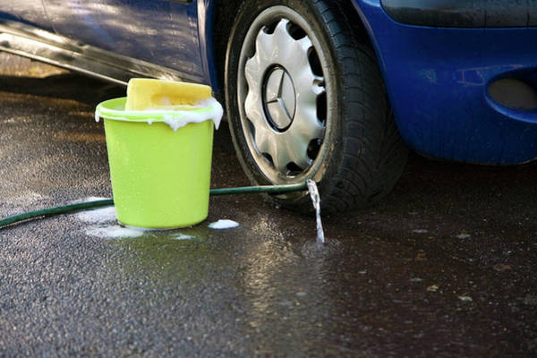 Car Wash Photograph - Wasting Water by Paul Rapson/science Photo Library