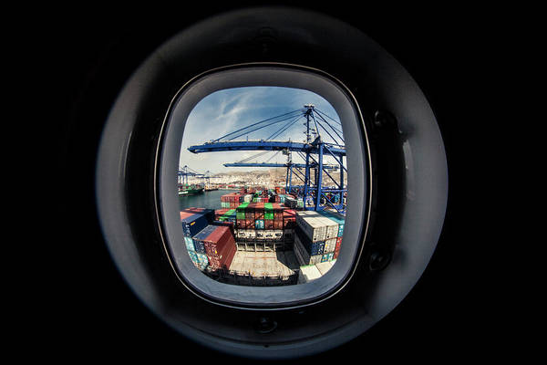 Wall Art - Photograph - Watching A Container Ship Being Loaded by Tim Martin