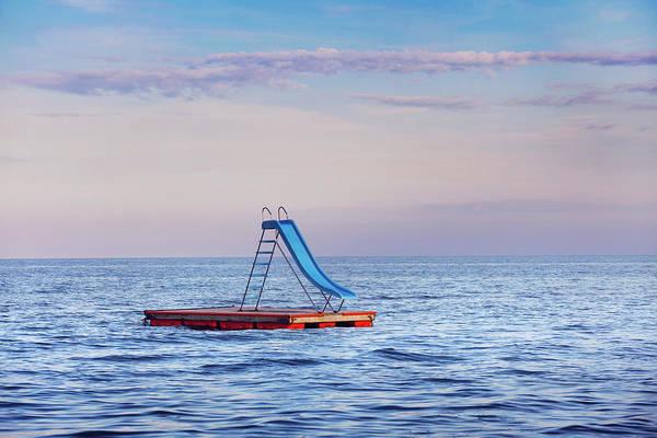 Raft Photograph - Water Slide On Raft In Ocean by Per Mattisson