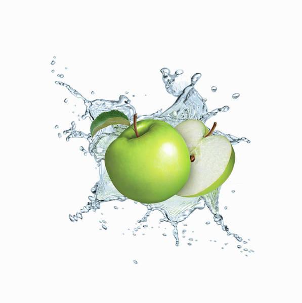 Exuberance Photograph - Water Splashing Around Green Apples by Ikon Ikon Images