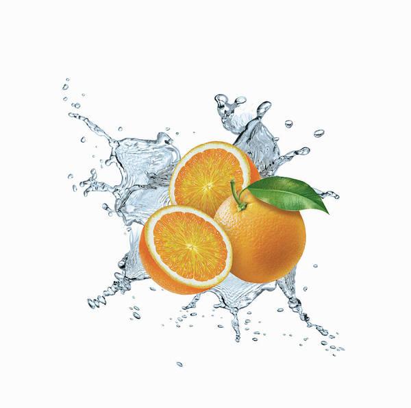 Exuberance Photograph - Water Splashing Around Oranges by Ikon Ikon Images
