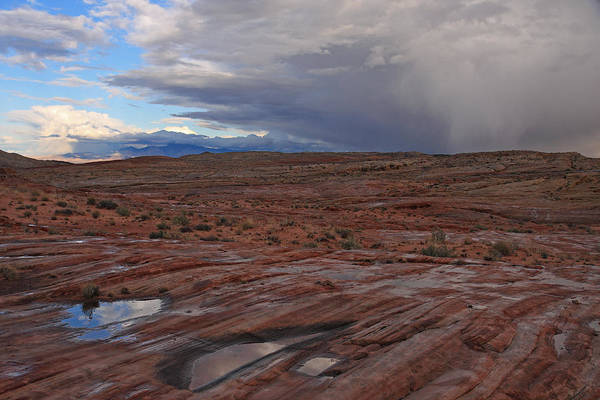 Photograph - Waterpockets And Storm At The Valley Of Fire by Steve Wolfe