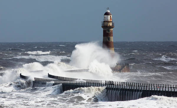 Sunderland Wall Art - Photograph - Waves Crashing Into A Lighthouse On The by John Short / Design Pics