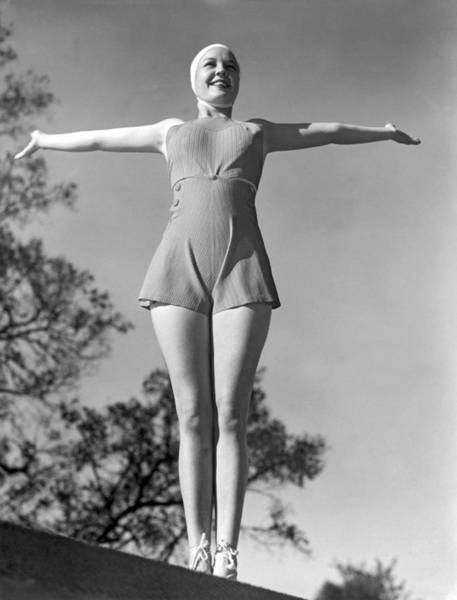 Modeling Photograph - Wearing A Rubber Bathing Suit by Underwood Archives