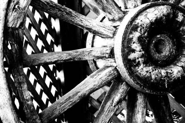 Photograph - Weathered Cart Wheel by David Rich