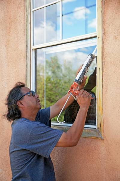 Conserved Photograph - Weatherproofing Windows by Jim West