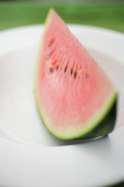 Wall Art - Photograph - Wedge Of Watermelon On Plate by Foodcollection