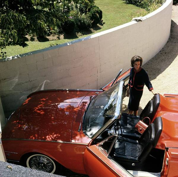 Driveway Photograph - Wendy Vanderbilt With A Thunderbird Convertible by Horst P. Horst
