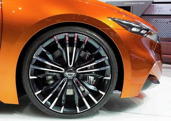 Auto Show Photograph - Wheel Of A Nissan Sport Sedan by Jim West