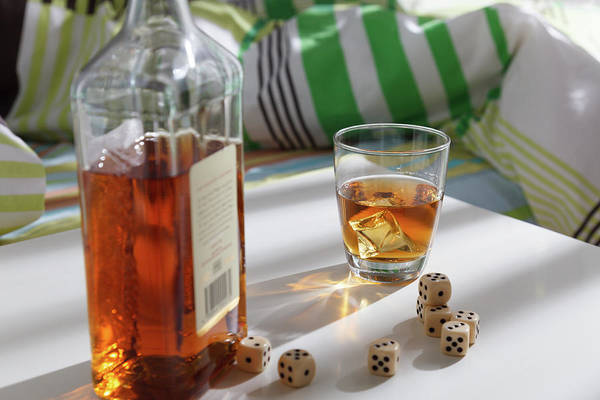 Wall Art - Photograph - Whiskey Bottle With Dice by Wladimir Bulgar/science Photo Library