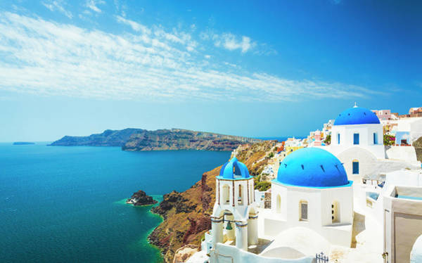 Volcanic Craters Photograph - White Church In Oia Town On Santorini by Spooh