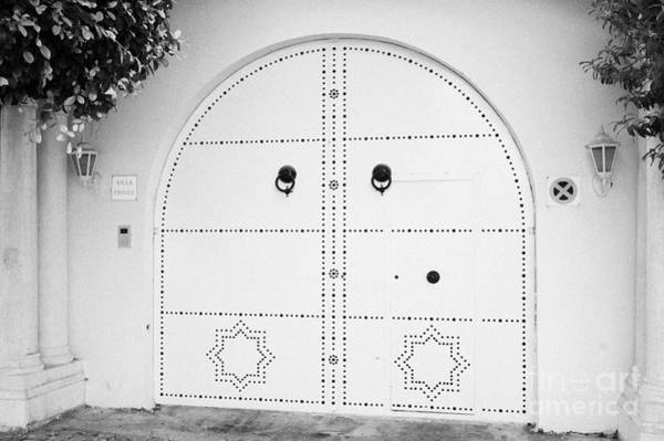 Hammamet Photograph - White Decorated Patterned High Security Gates At Entrance To Private House With Warning Sign Hammamet Tunisia by Joe Fox