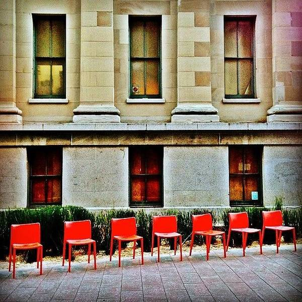 Wall Art - Photograph - Seven Red Chairs by Julie Gebhardt