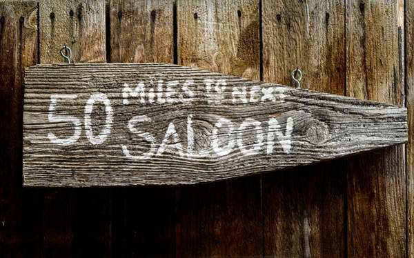 Far Away Wall Art - Photograph - Wild West Saloon Sign by Mr Doomits
