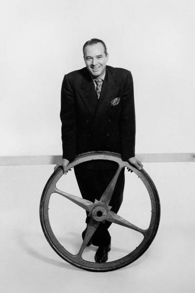 Wheel Photograph - William Pahlmann Holding A Wheel by Herbert Matter