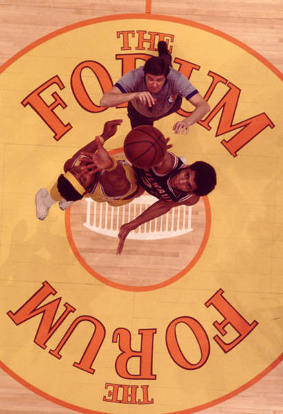 Wall Art - Photograph - Wilt Chamberlain Vs. Kareem Abdul Jabbar Tip Off by Retro Images Archive
