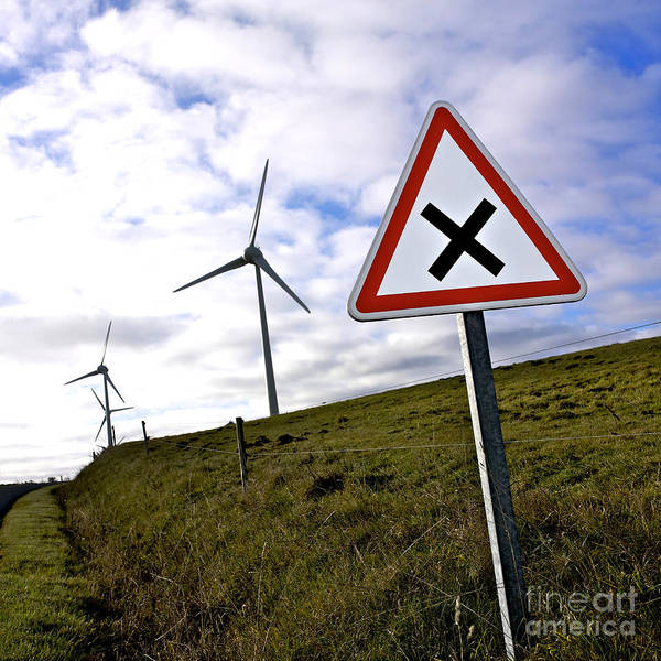 Wind Generator Photograph - Wind Turbines On The Edge Of A Field With A Road Sign In Foreground. by Bernard Jaubert