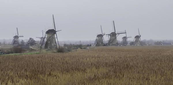 Blye Photograph - Windmills At Kinderdijk by Kenneth Blye