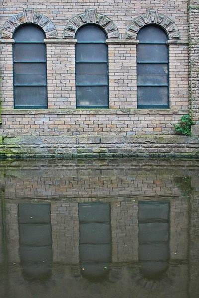 Photograph - Windows Reflected In Water by Jeremy Hayden