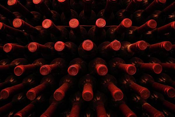 Italian Wine Photograph - Wine Bottles In A Rack by Mauro Fermariello/science Photo Library